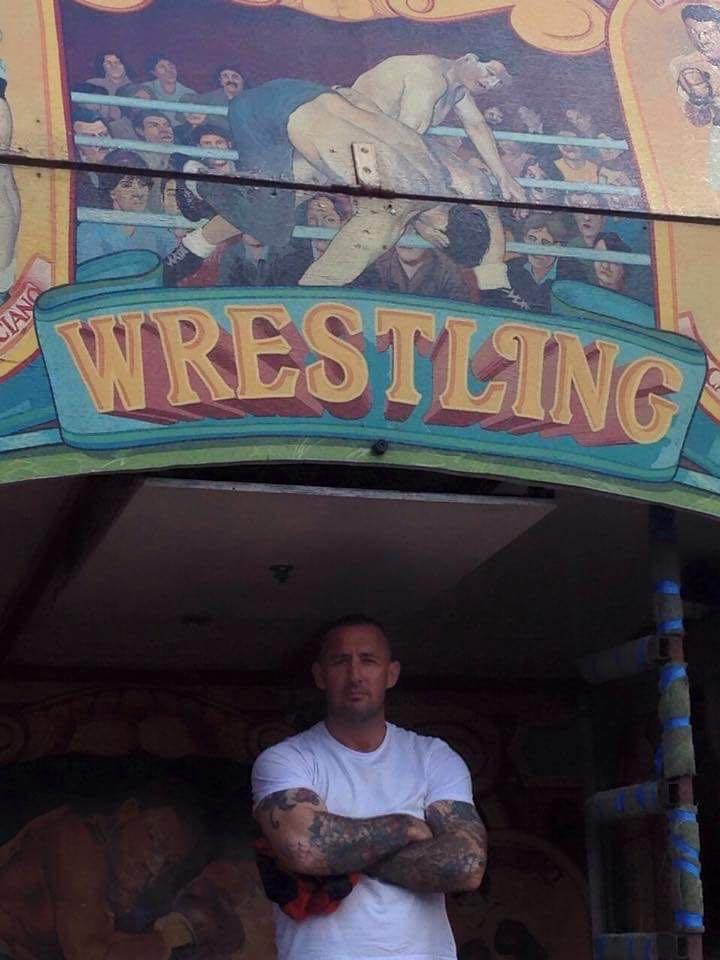 Coach Chris Crossan outside the wrestling booth